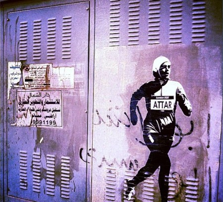 Graffiti of Sarah's image running in the Olympics by the artist Shaweesh